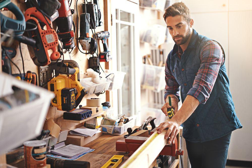 Man working in an organized garage