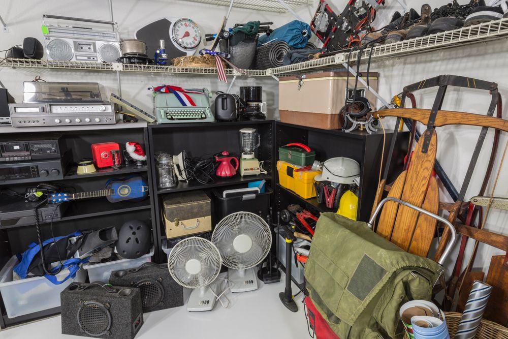 Cluttered garage with black shelves