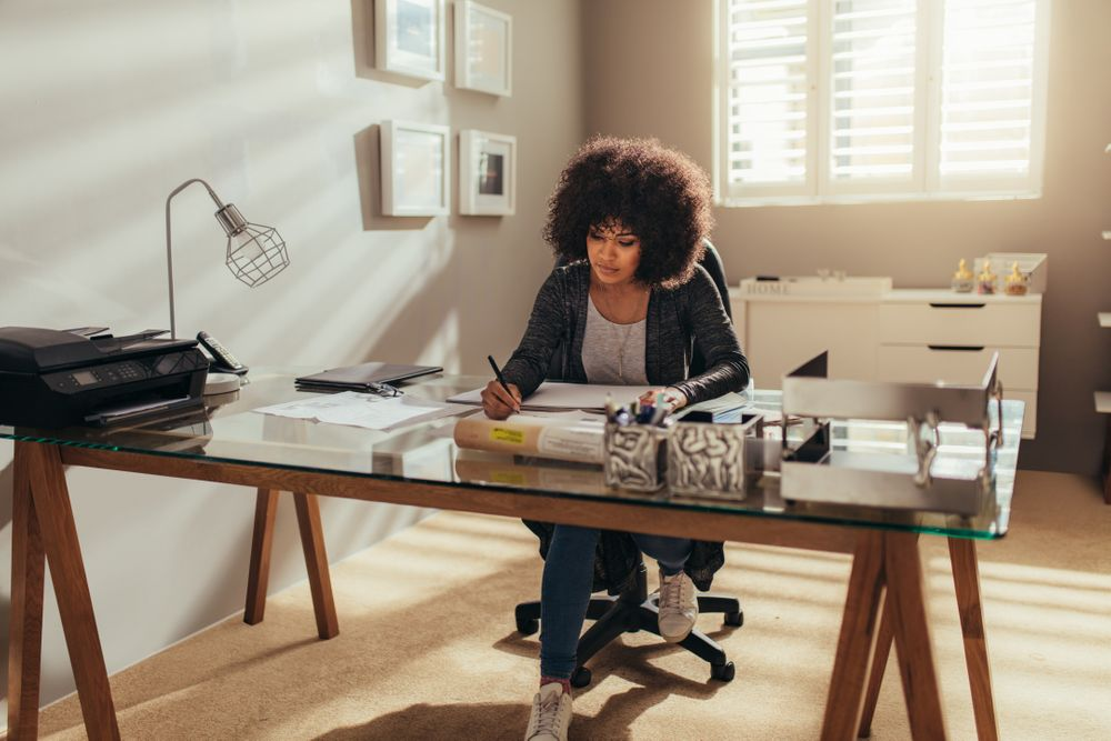 African-American woman working in her home office