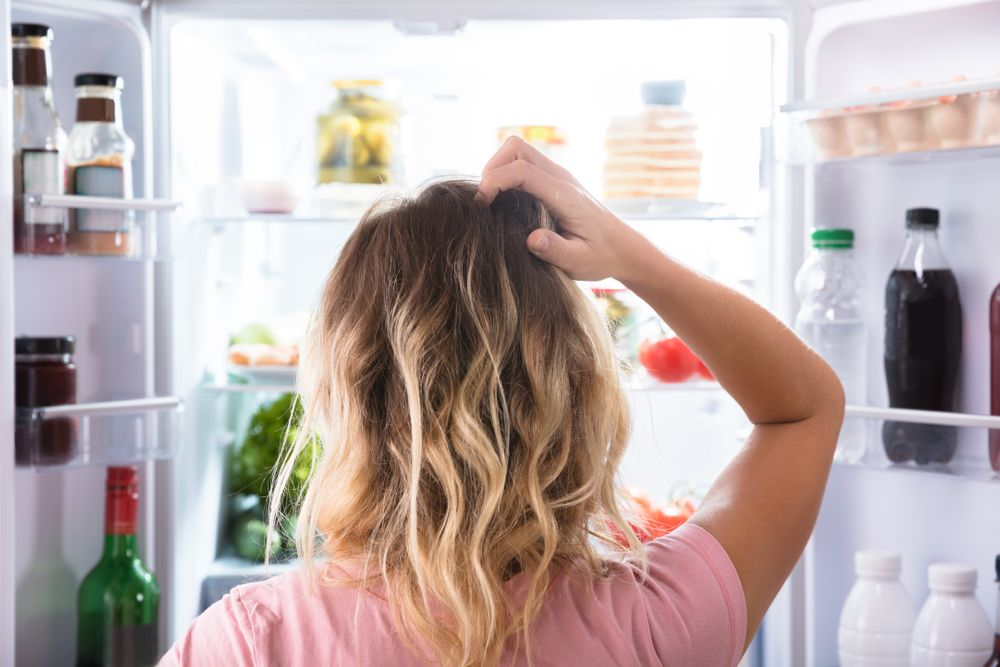 Woman in front of a fridge