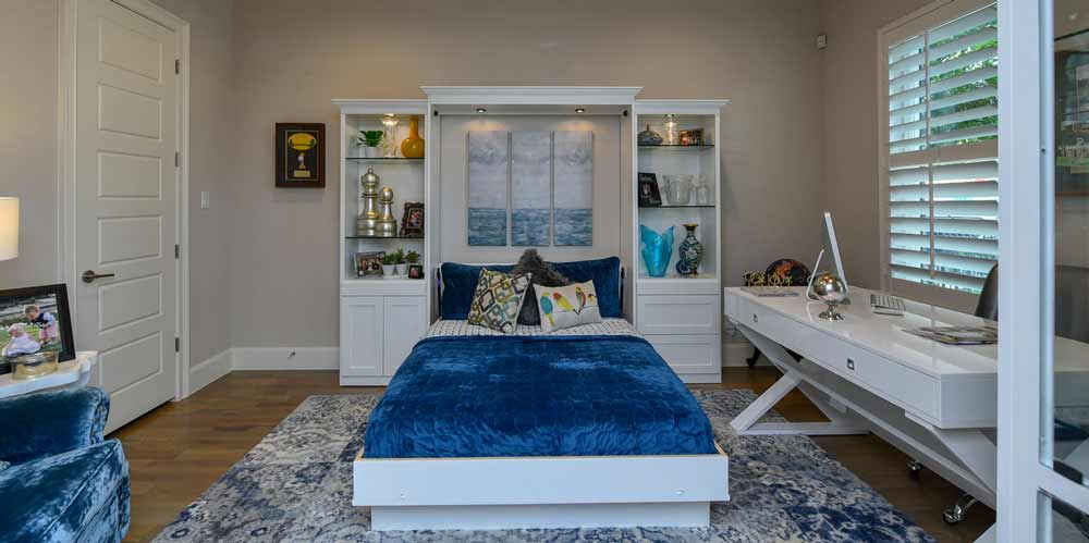 wall bed with blue comforter
