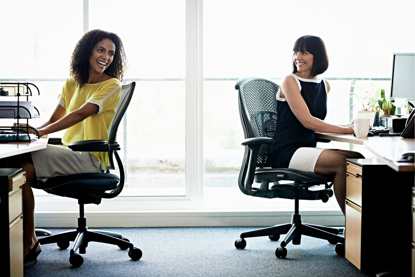 Female workers in office chairs