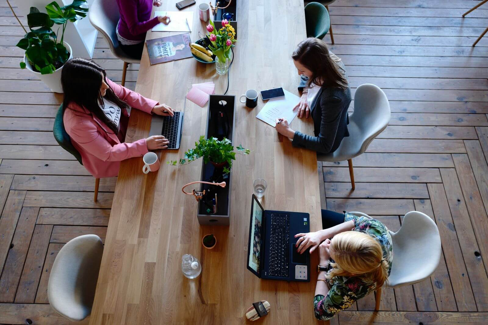 Women working at large, open desk