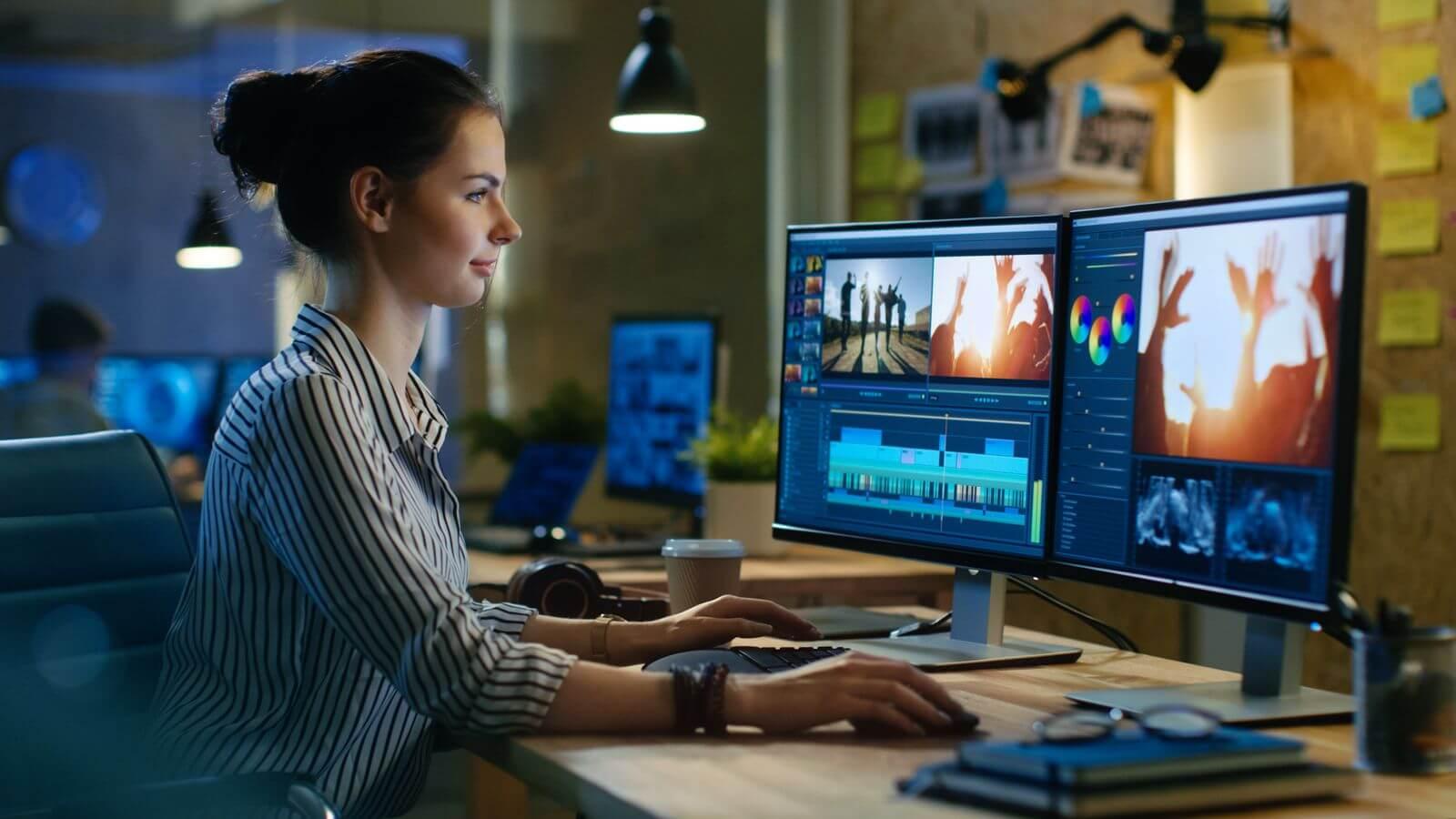 Woman creating video on desktop computer