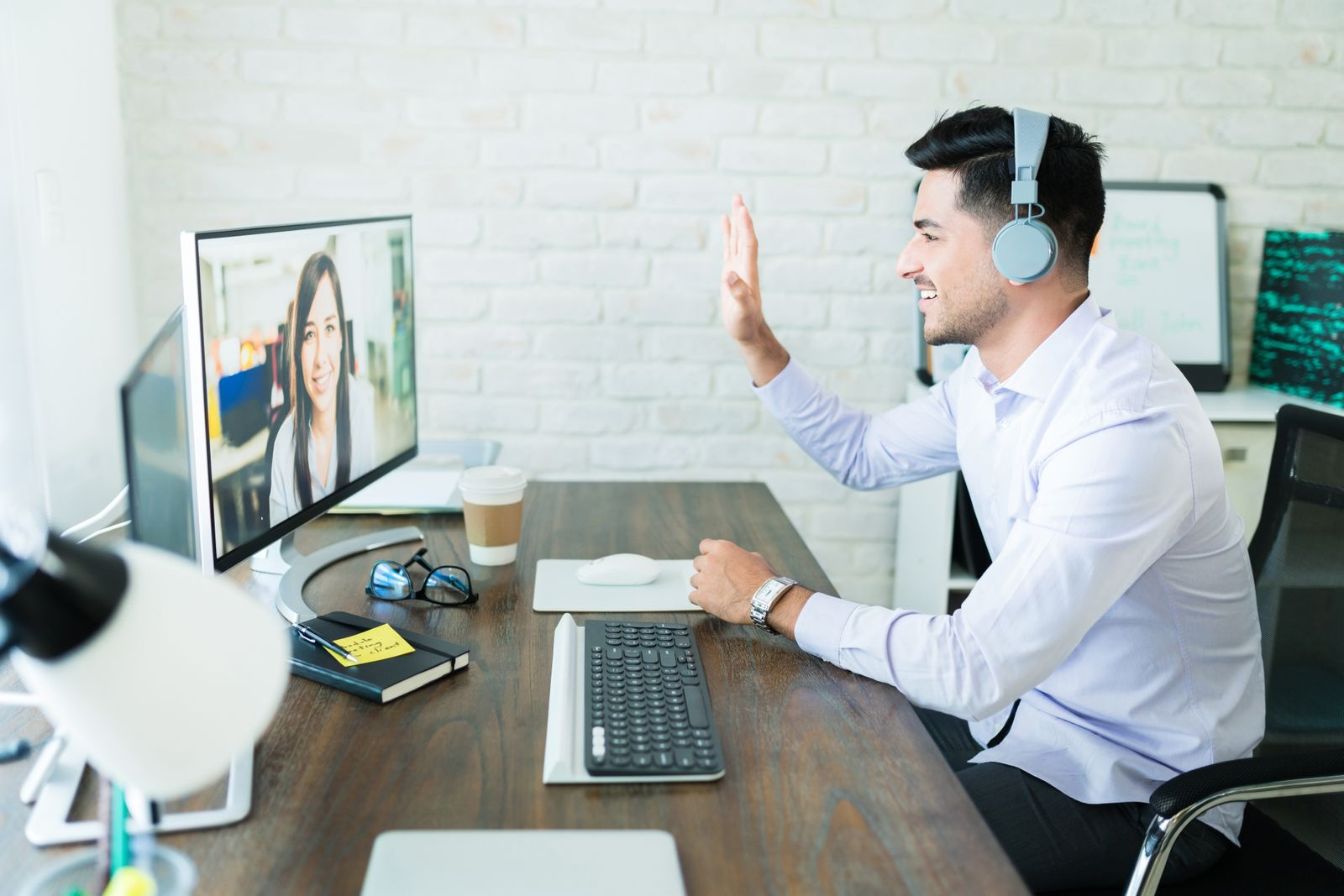 Young man videoconferencing with his coworker