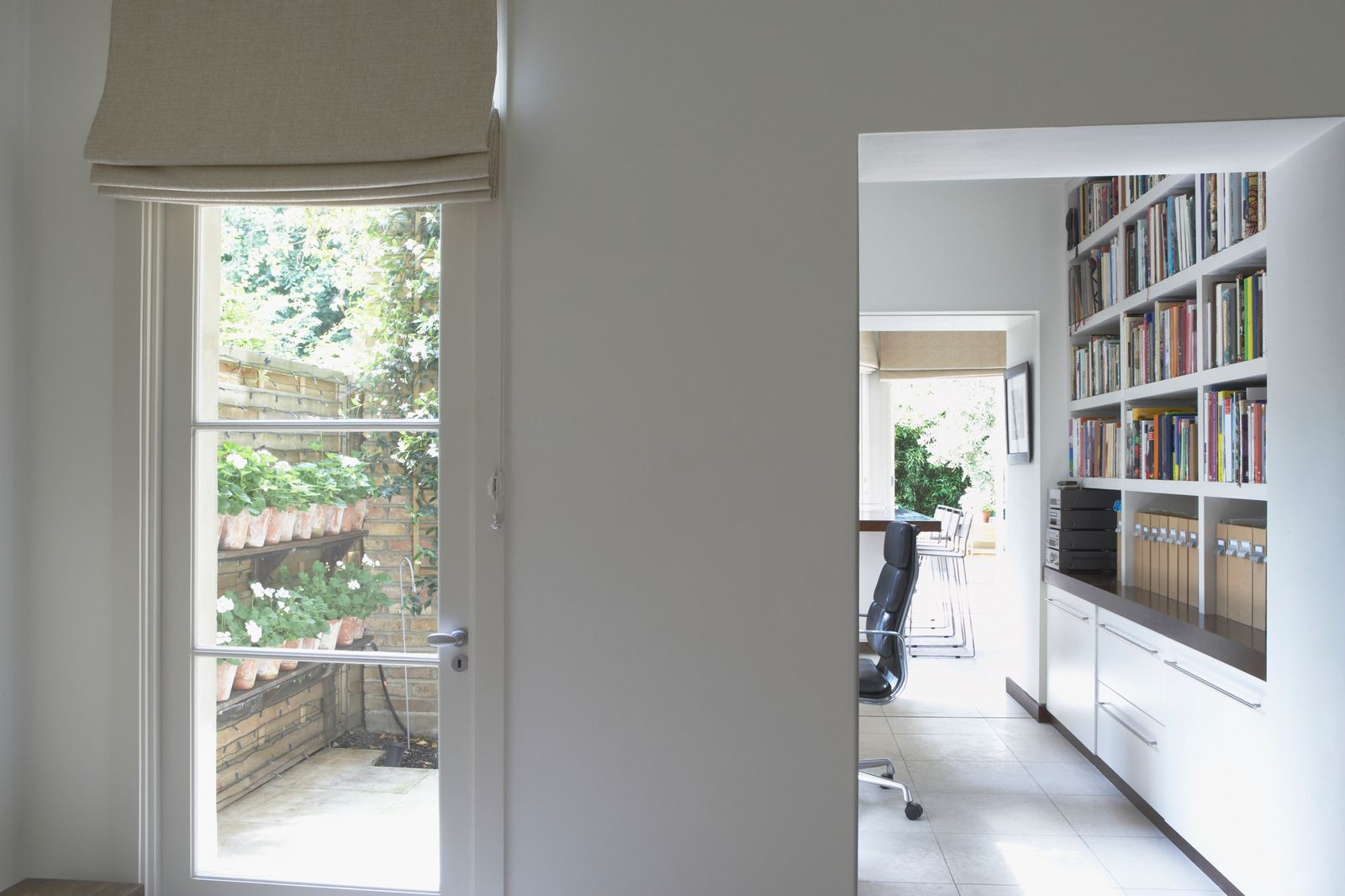 Floor-to-ceiling shelves in a home office