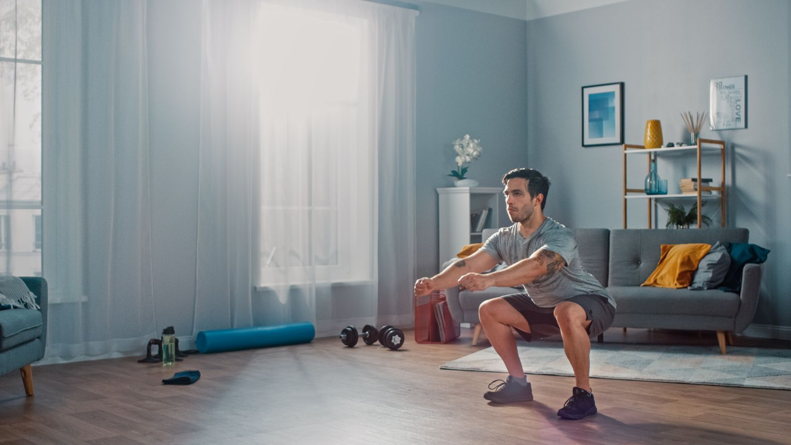 Man working out in living room