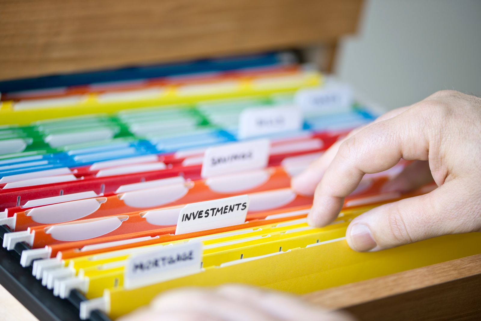 Person looking through color-coded folders