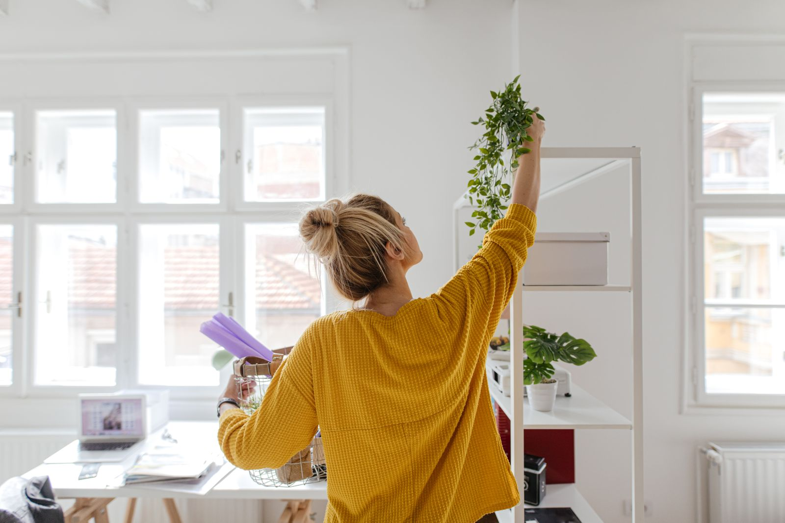 Woman decorating her home office
