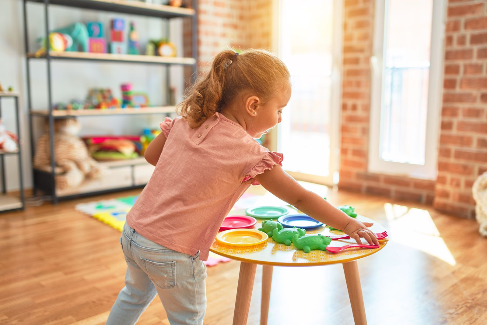 Little girl in a bright playroom