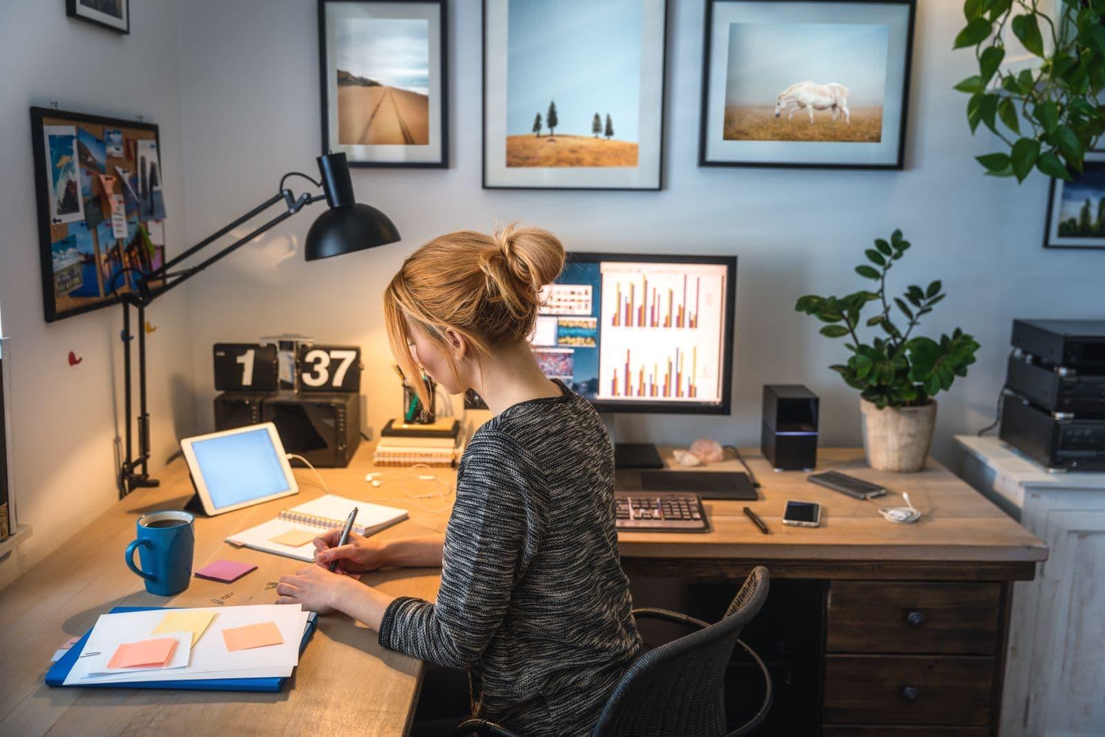 women working on an L shaped desk