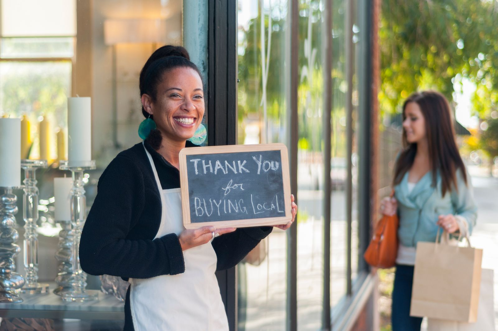 Local business owner thanking people for buying local