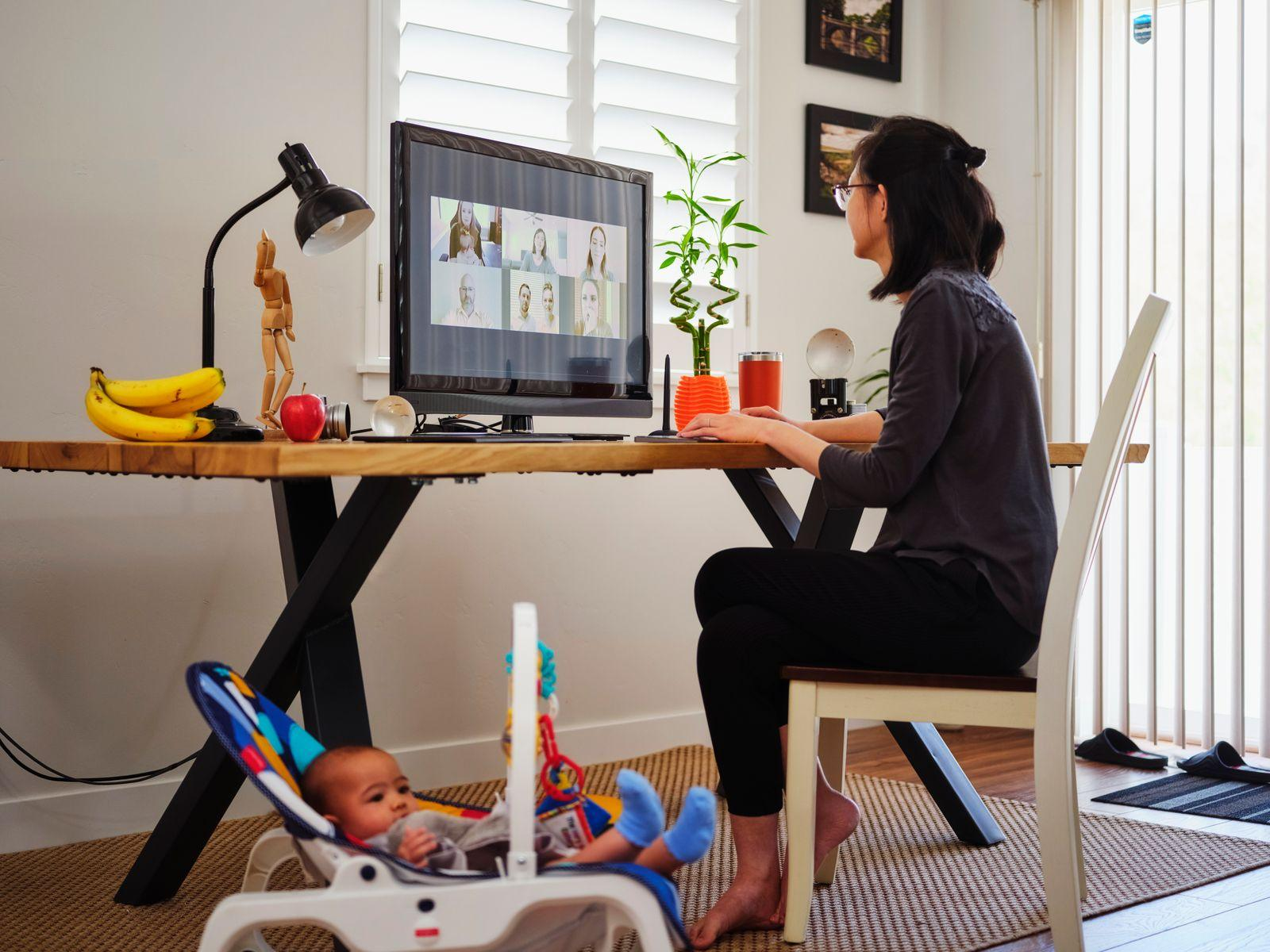 Mom working from home with her baby