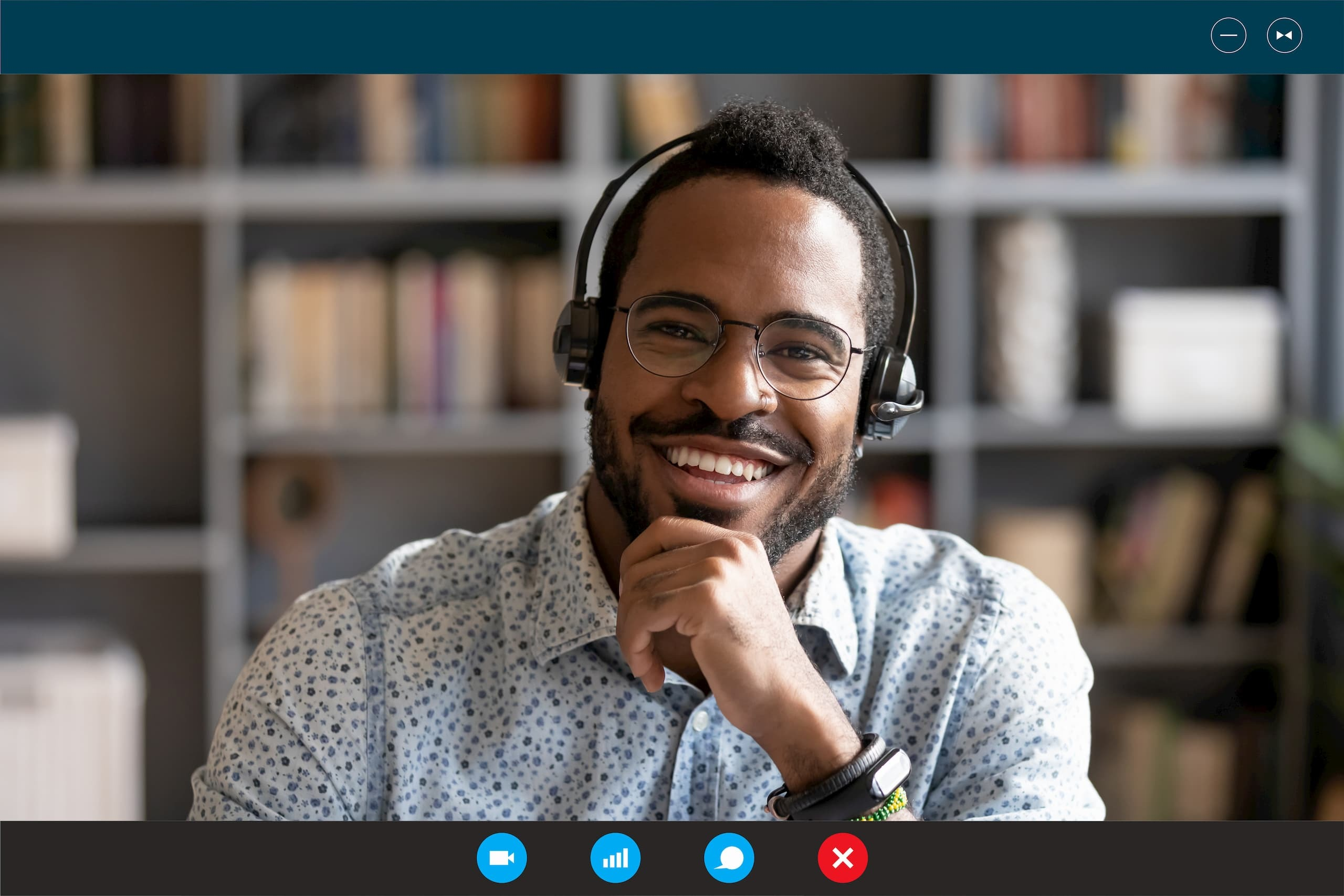 Happy man wearing headphones for a video conference