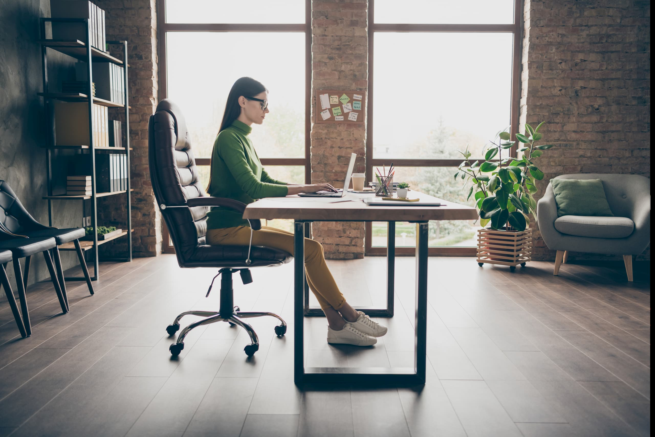 Woman working from home in an ergonomic office chair