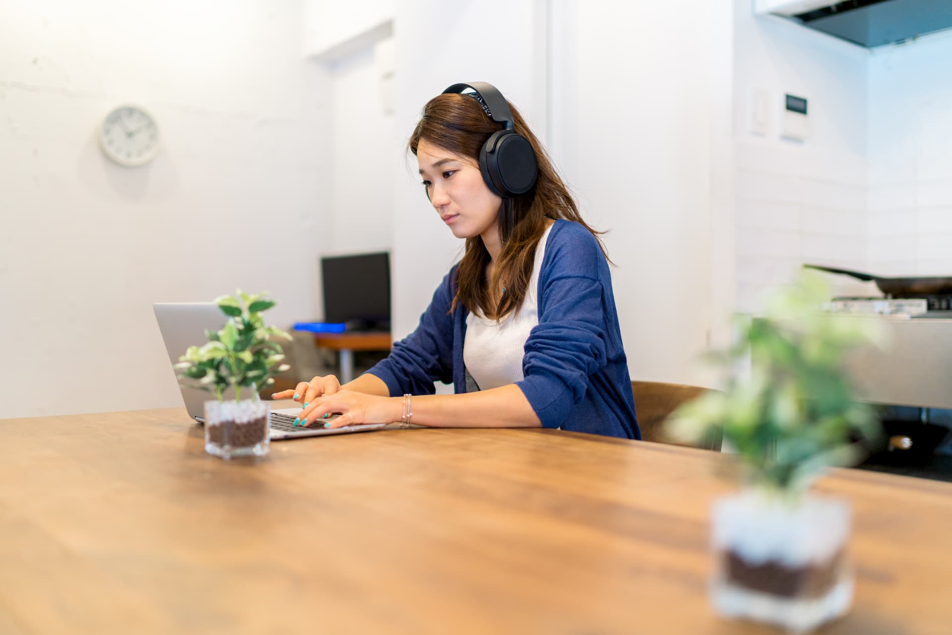 Woman sitting at a table with headphones