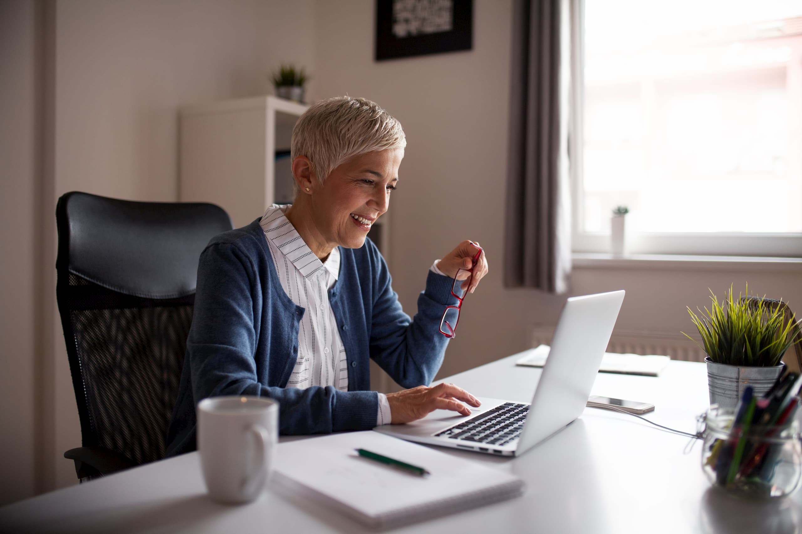 Older woman working in her home office