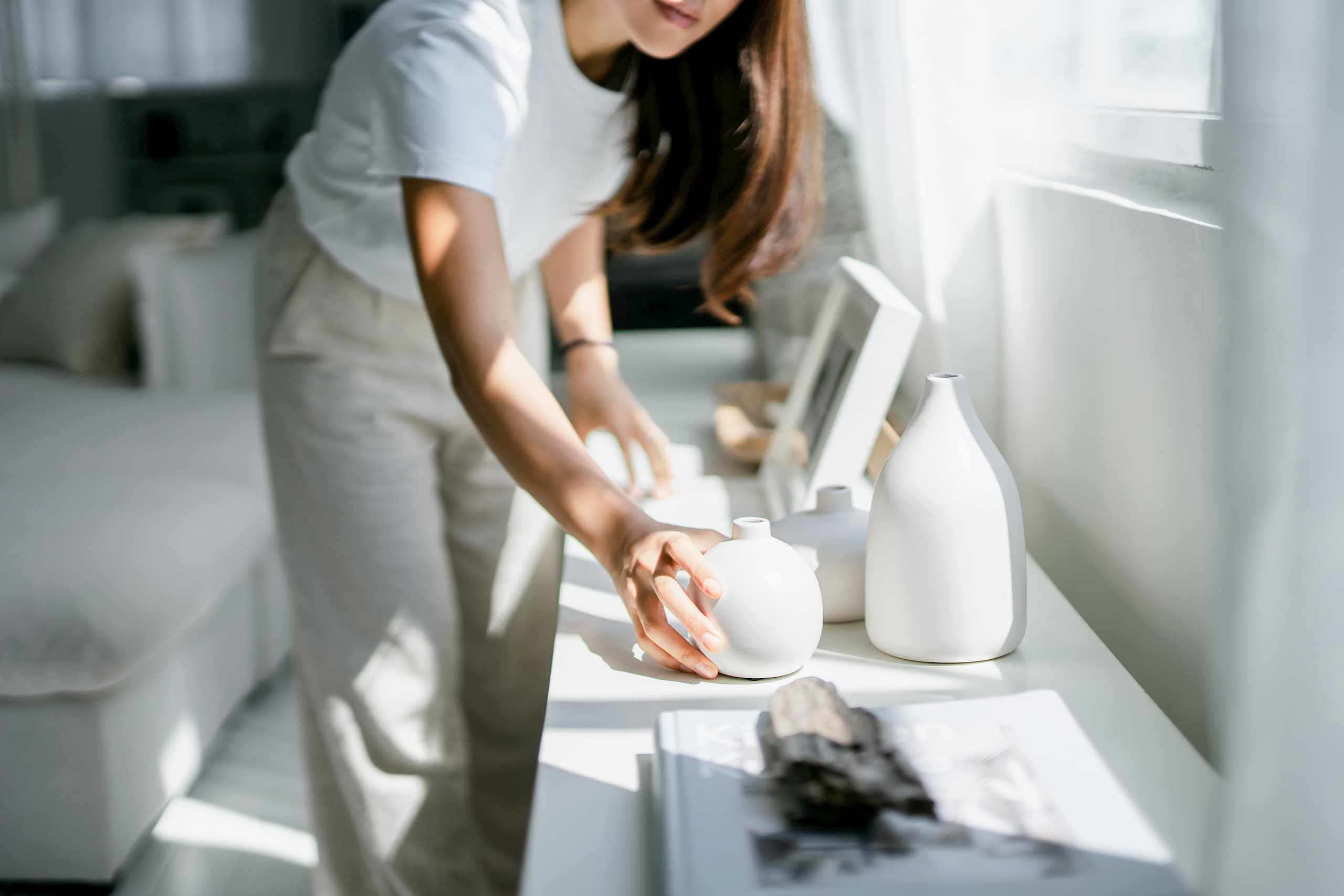 Woman decorating and organizing her space