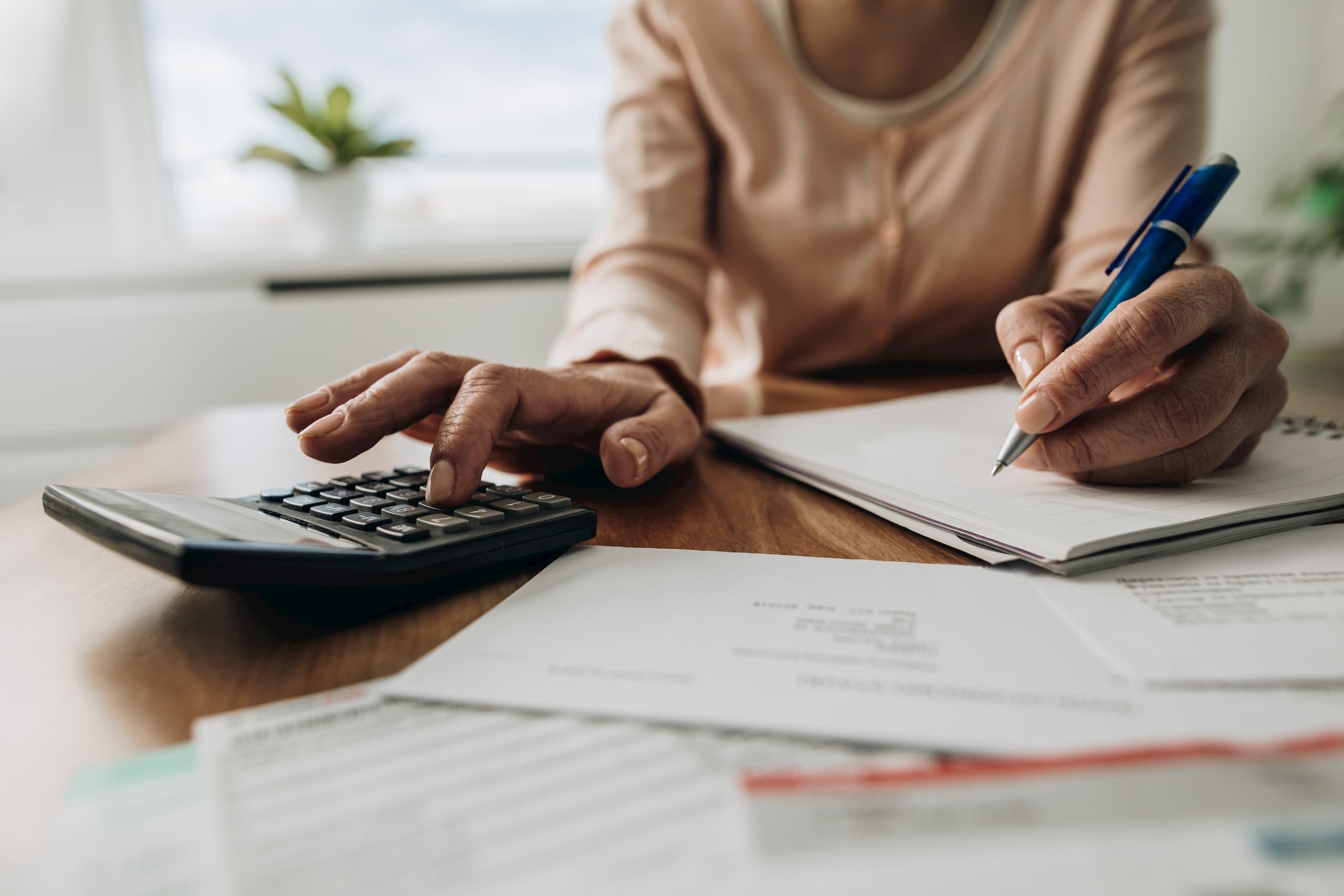 woman calculator budget home