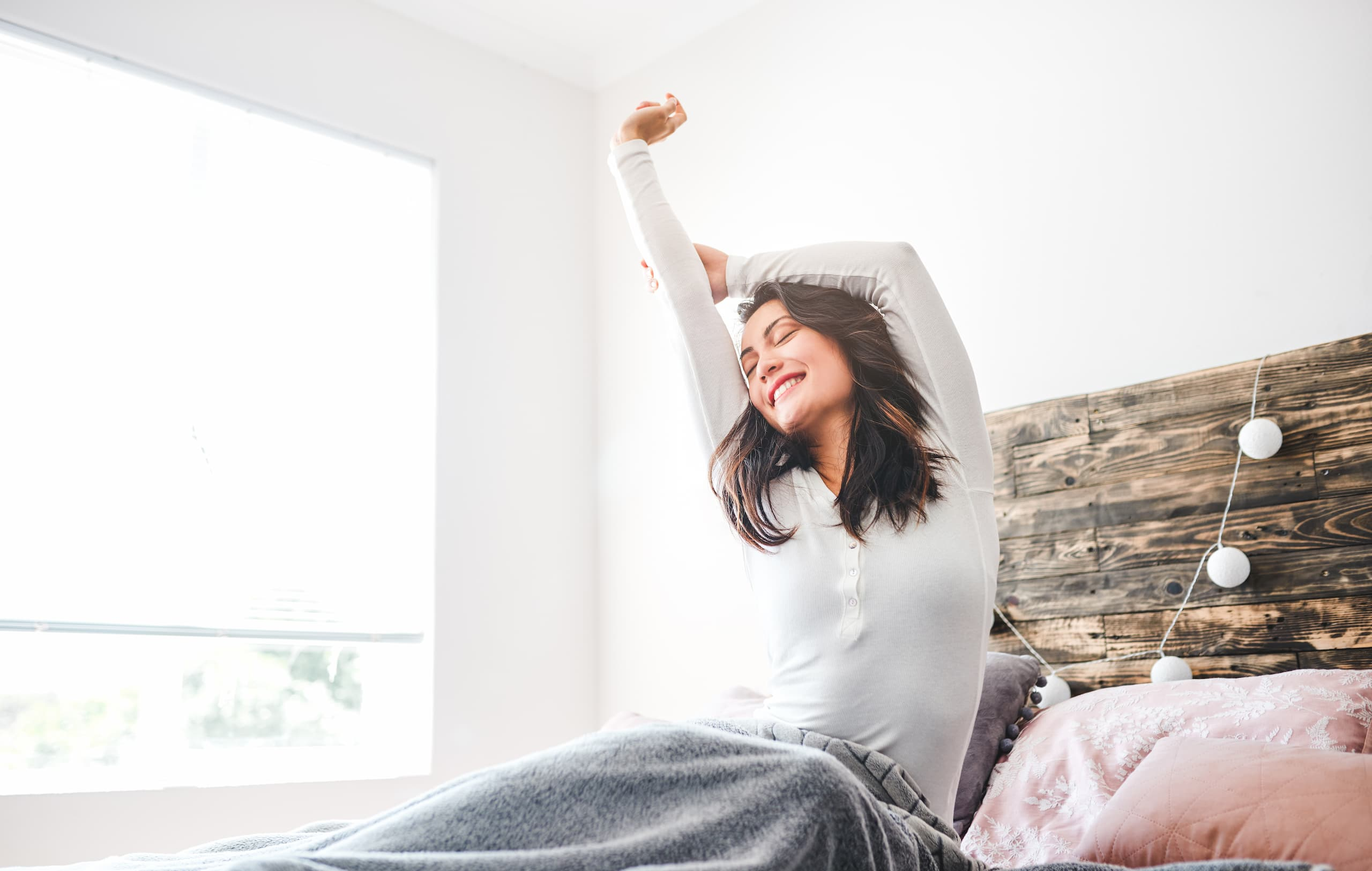 woman waking up white room