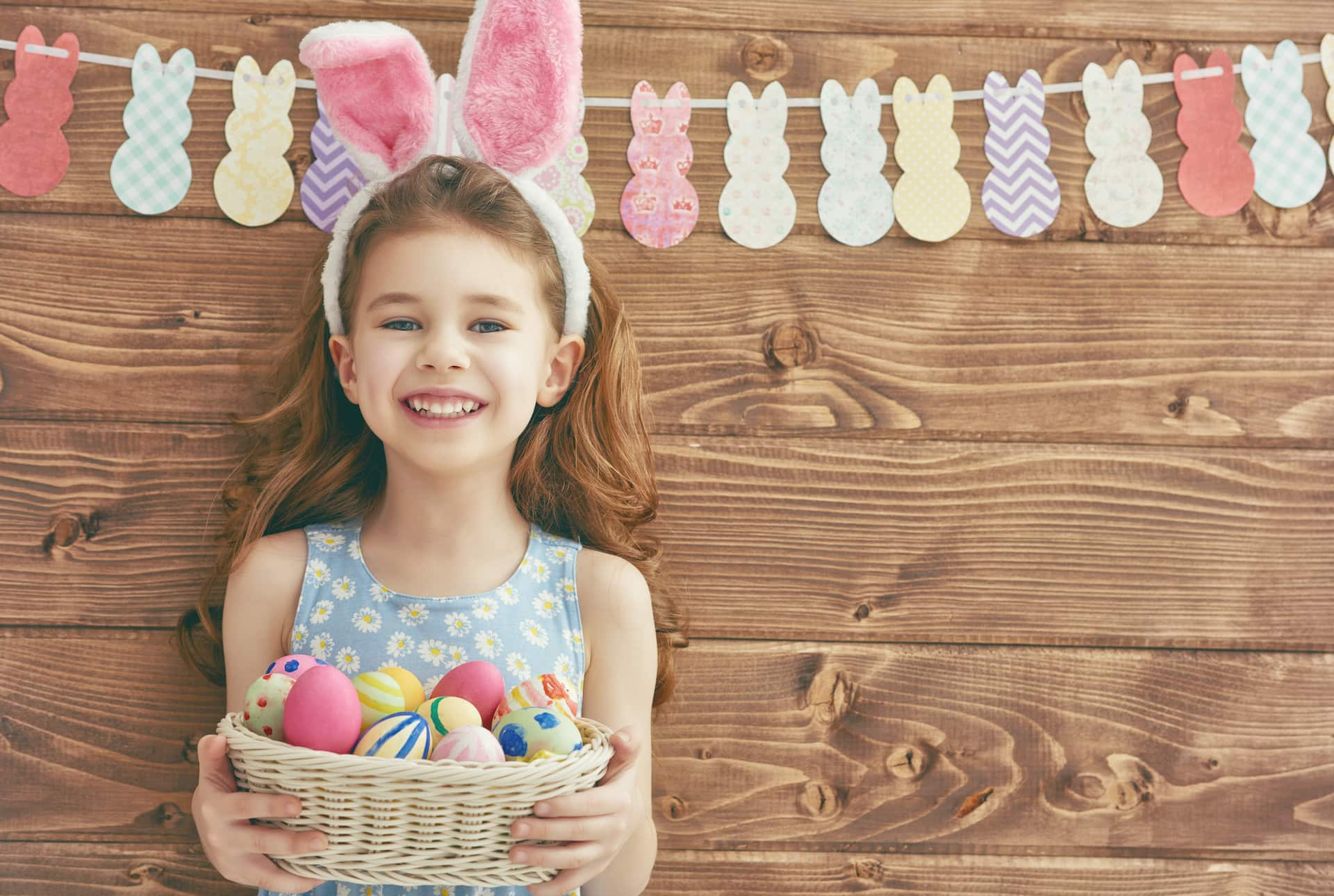 little girl with garland and easter egg basket