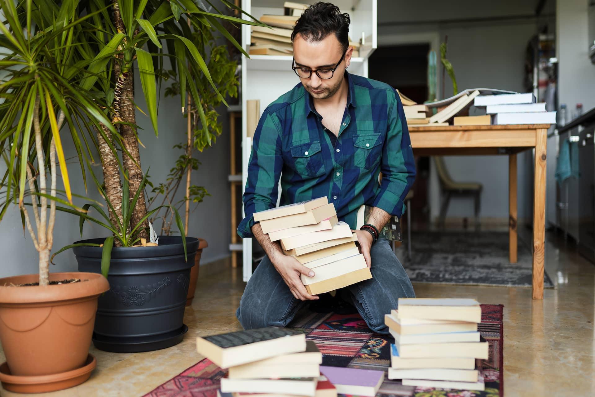 man dropping books