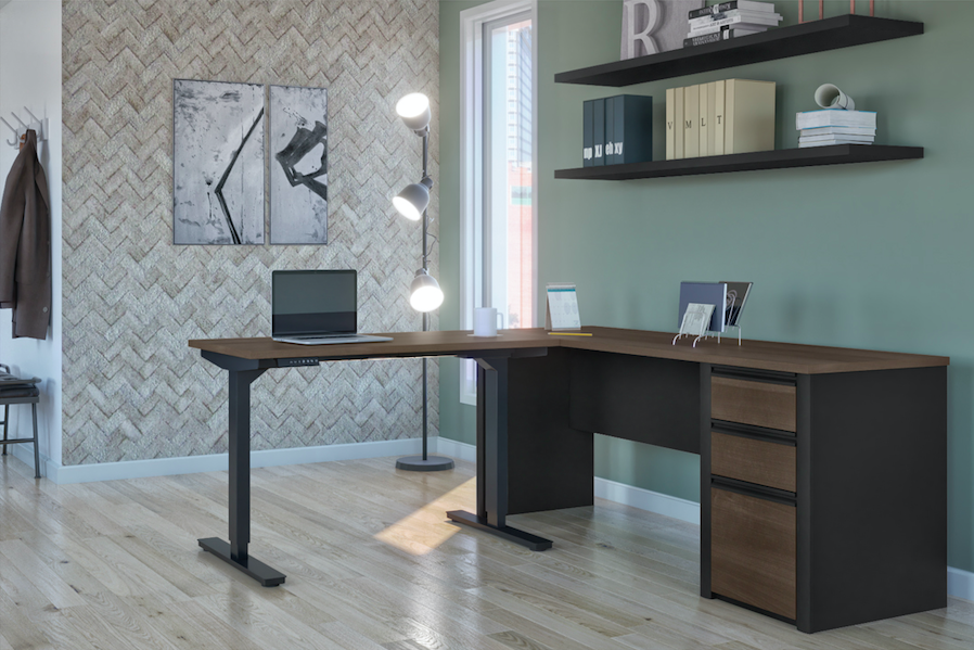 standing desk with storage with shelves and patterned wall and lights
