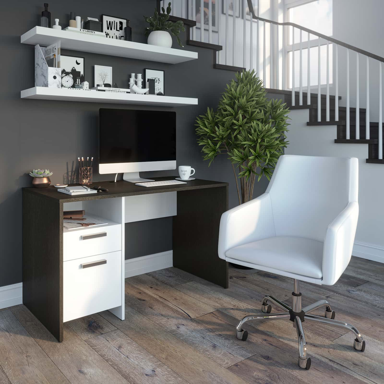 small home office desks with shelves on the wall over the desk. white swivel chair. big potted plant on the right. staircase on the right.