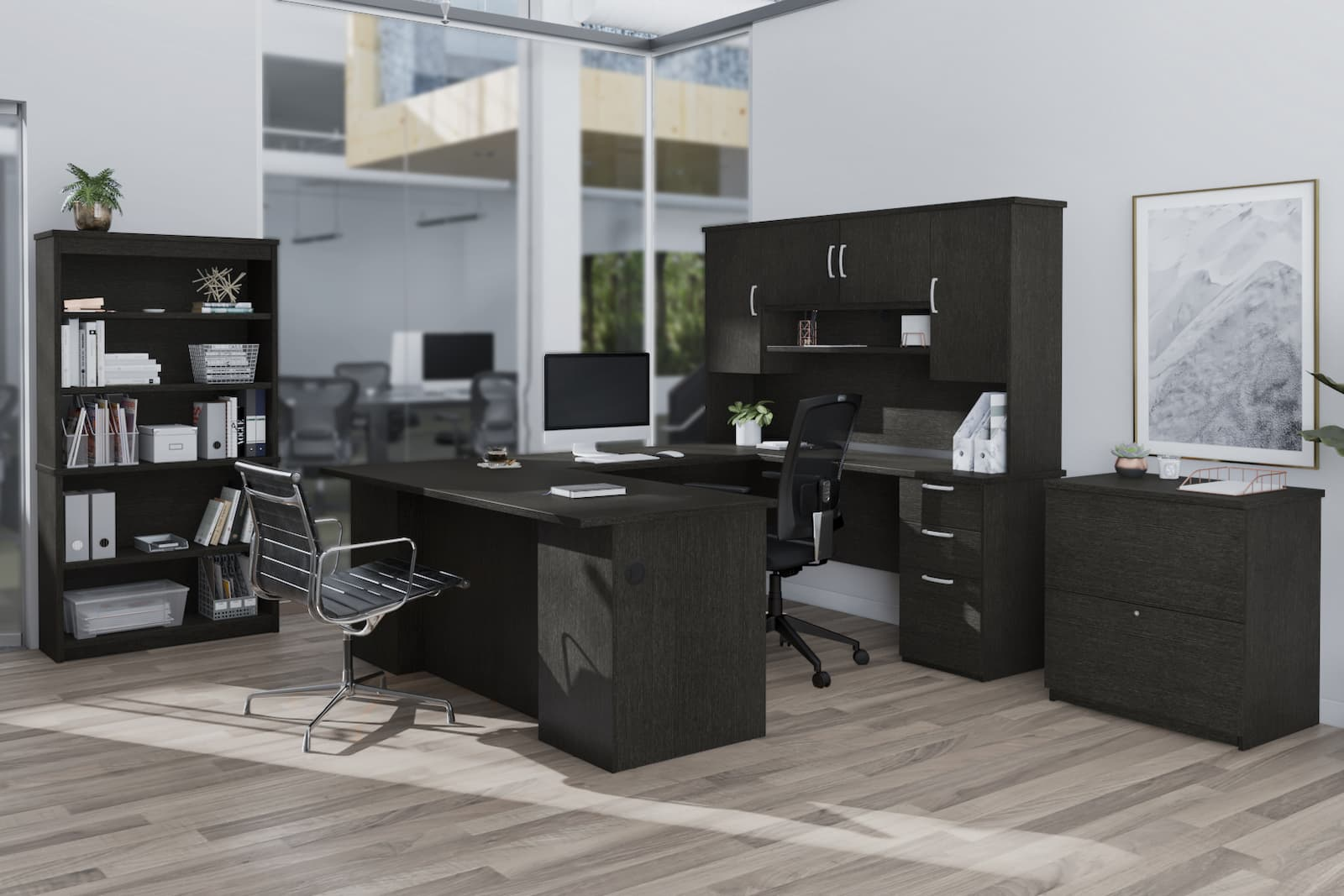 black u shaped executive desk in private commercial office with big windows