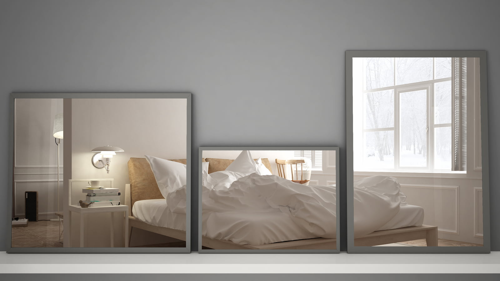 three mirrors reflect white bed and bedroom