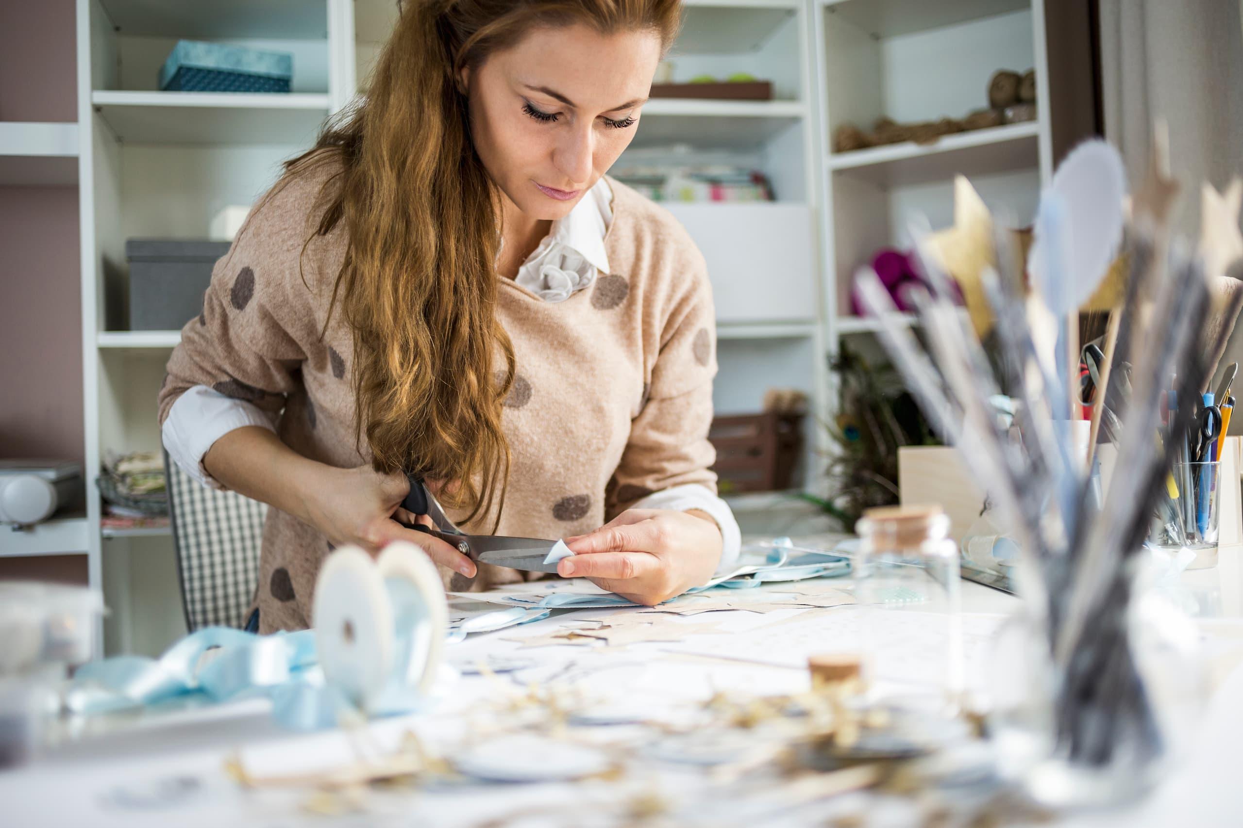 Woman creating a DIY desk organizer