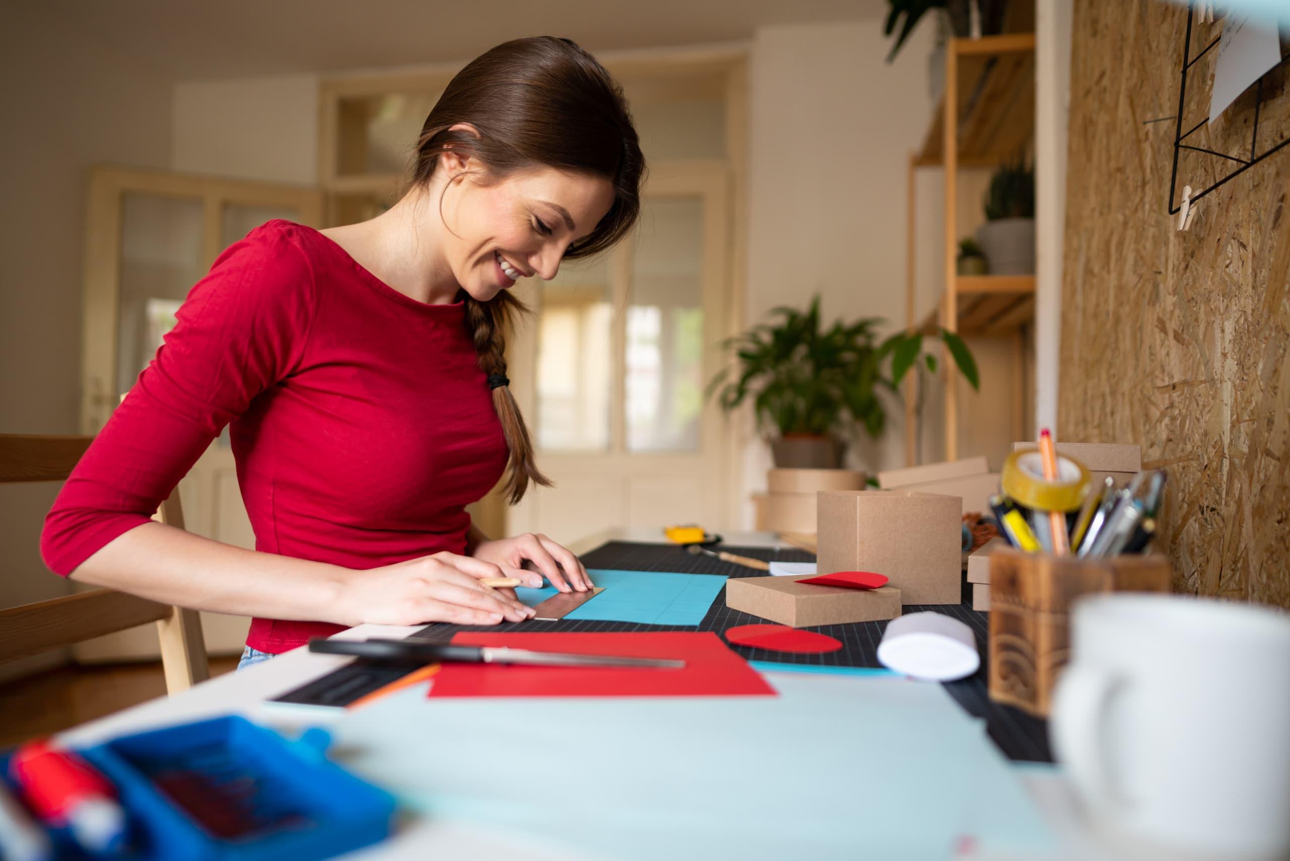 Woman happily making a DIY desk organizer